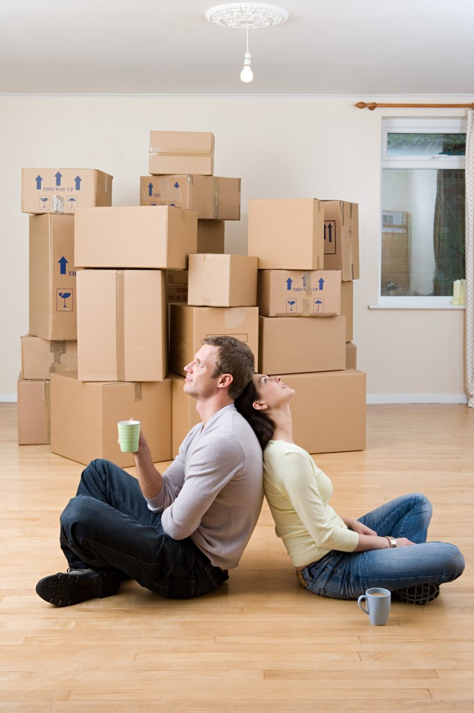 Couple taking a break from unpacking